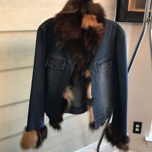 Denim jacket with fox fur trim.